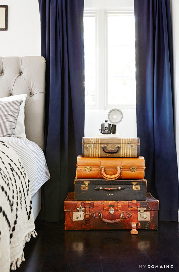 Suitcase Stack Nightstand - Wanderlust Style: Suitcases as Decor - www.AFriendAfar